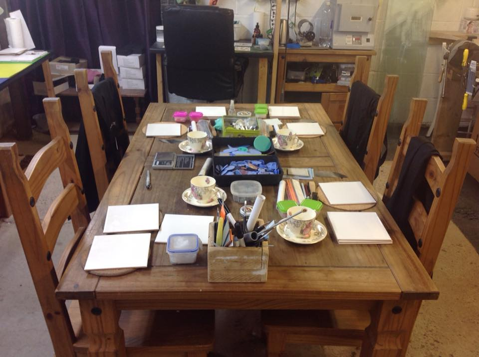 The workshop table set up for a class